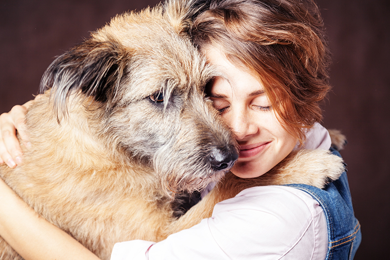 woman hugging big dog