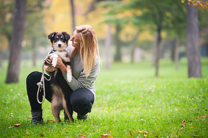 woman with dog at park